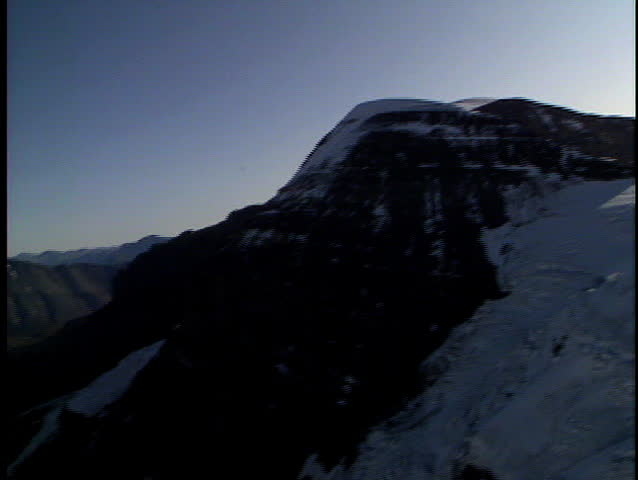 Fly up snow to reveal the spectacular Columbia Icefields in Banff National Park Canada