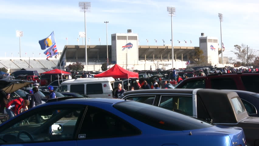 ORCHARD PARK, NY -  CIRCA DEC 2012: Fans in the parking lot during game as the Buffalo Bills miss the play offs for the 12th consecutive year circa December 2012 in Orchard Park, NY.