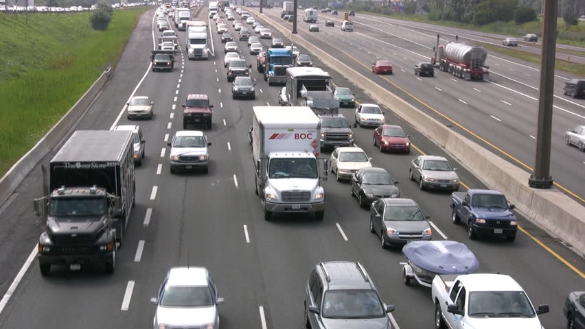 TORONTO - CIRCA SEPT 2012: Canada's busiest highway the 401 is grinding to a halt with volume of traffic circa September 2012 in Toronto, Canada. - HD stock footage clip