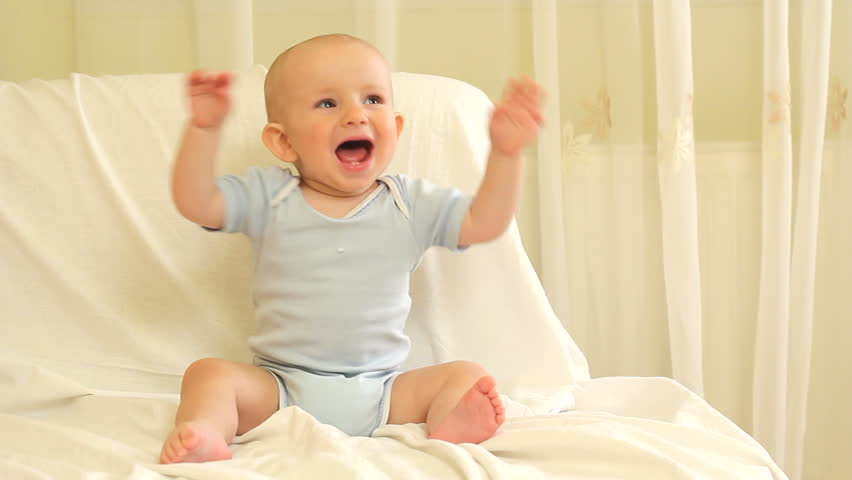 Adorable baby laughing and clapping hands