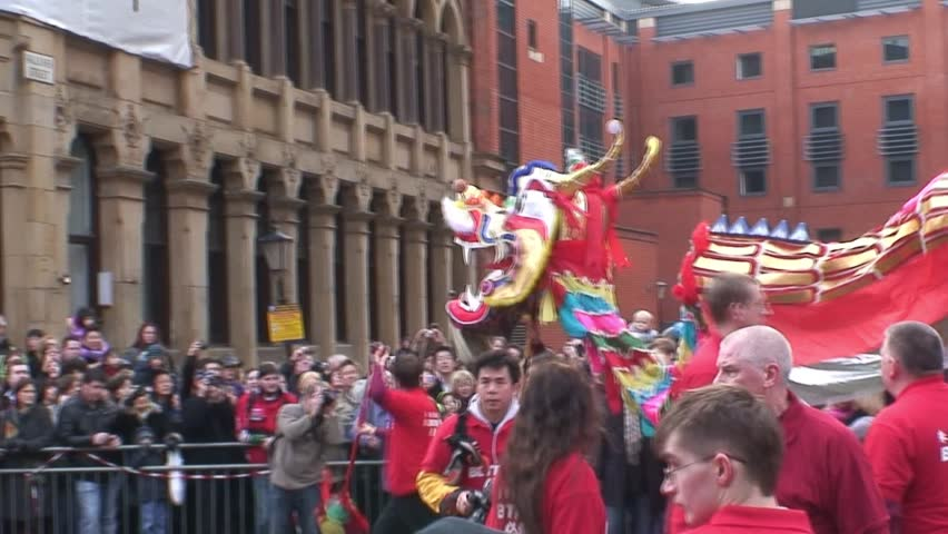 MANCHESTER, UNITED KINGDOM - CIRCA 2011: Chinese New Year dragon dance with drum at China Town in Manchester.