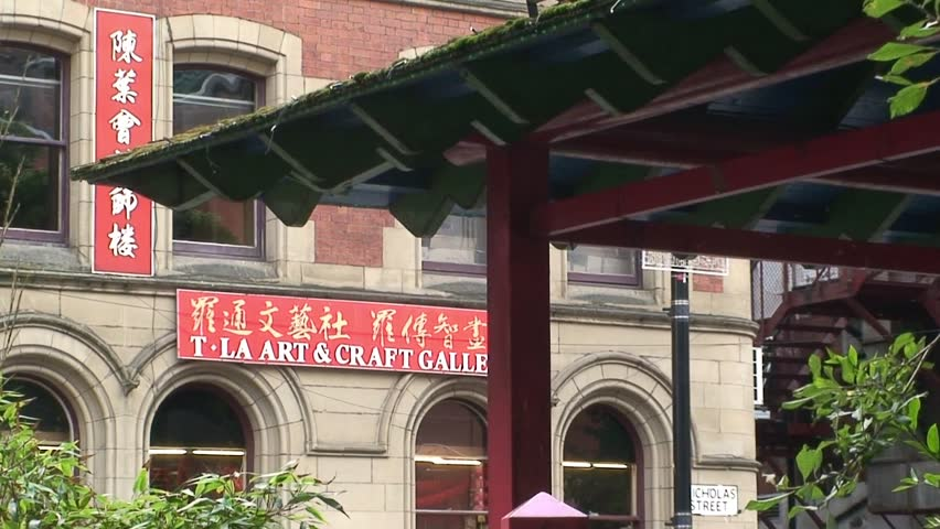 MANCHESTER, ENGLAND - CIRCA 2011: View of shops and Pagoda building in Manchester's China Town.