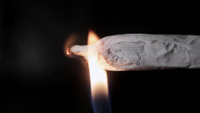 Close up of lighting marijuana joint