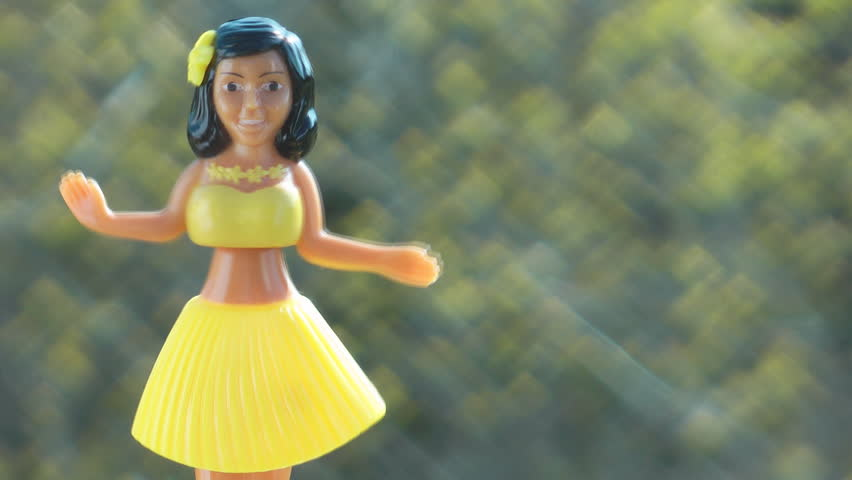 Traditional Plastic Toy Hawaiian Hula Dancing Outside In The Sunshine
