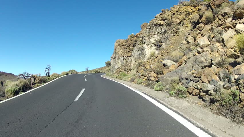 Driving in volcano landscape on Tenerife, Spain filmed with a GoPro Hero 2 HD mounted on the hood of the car. - HD stock video clip