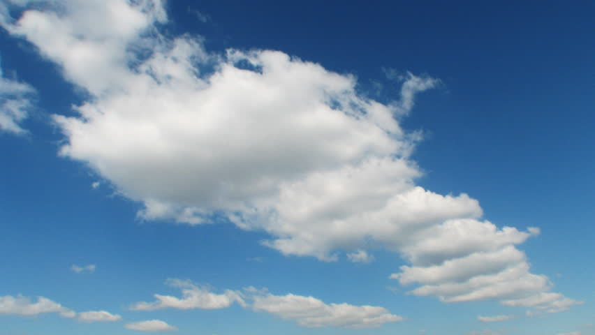 Time lapse clip of white fluffy clouds over blue sky - HD stock footage clip