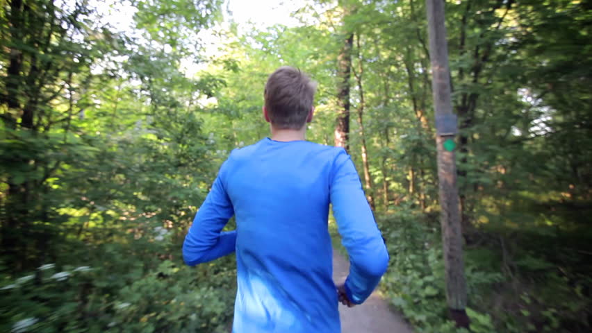 Man running through the forest