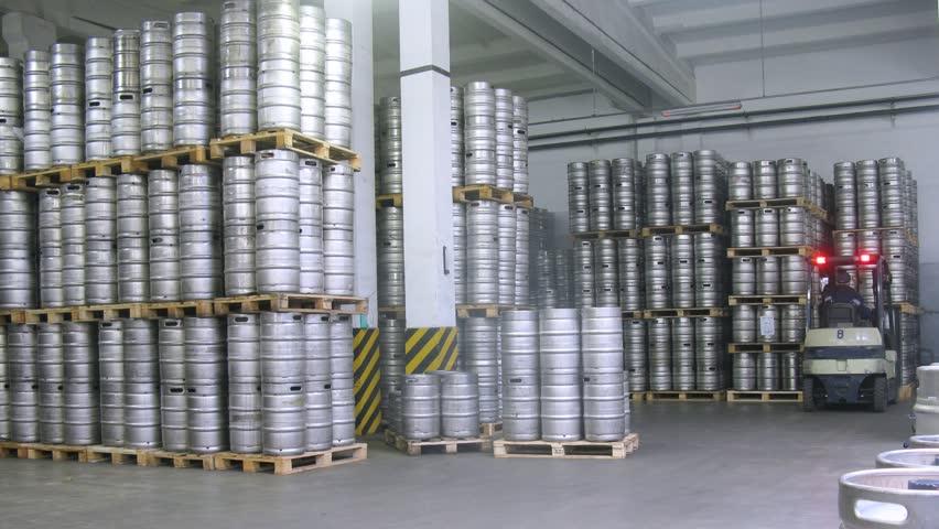 Forklift operator arrange keg pallet in warehouse. Timelapse