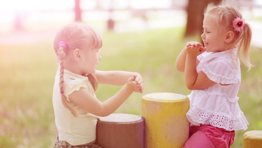 Sunny girls outdoors.Children playing in the Kids Count. Slow motion - HD stock video clip