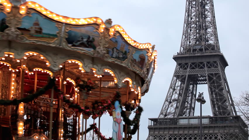 Eiffel Tower and Carousel (merry go round) in Paris, France, French Architecture - HD stock footage clip