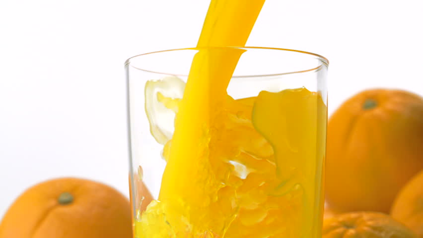Pouring orange juice into glass shooting with high speed camera, phantom flex.