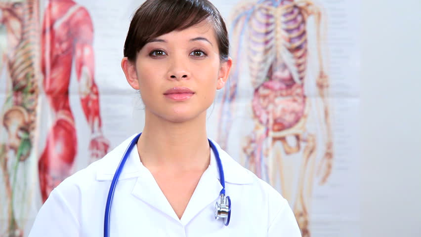 Western oriental medical student training in clinical healthcare - HD stock footage clip
