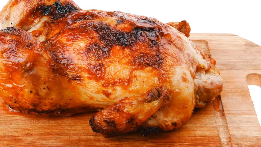 poultry : homemade roast whole turkey on wooden cutting board