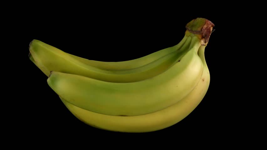 Bunch of Bananas rotating on black background - Looping - HD stock video clip