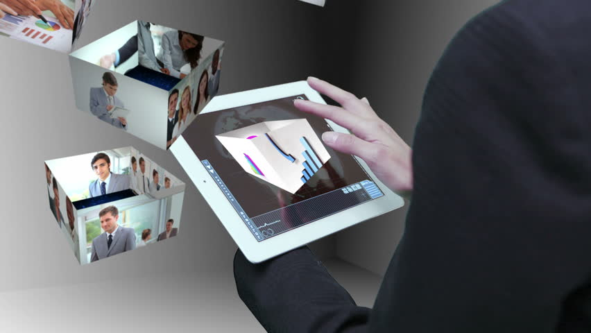 Businesswoman using tablet to view montage of business people at work in holographic form - HD stock footage clip