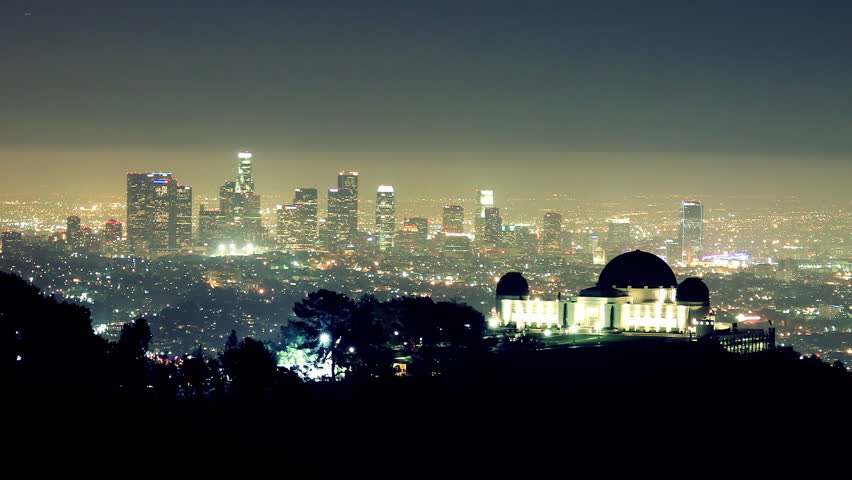 Noctural Time Lapse of Griffith Observatory in Foreground with Downtown LA in the Background