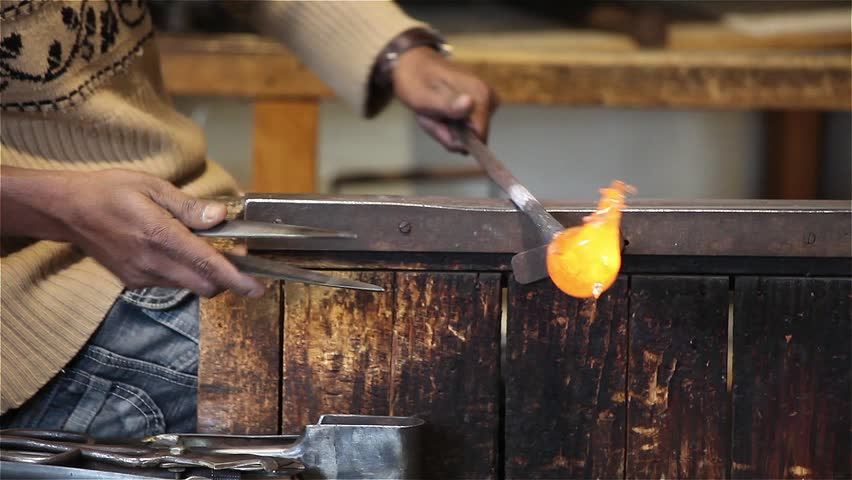 Artisan Modelling Glass - Video clip of artisan of glass creating a glass horse - Murano, Venice, Italy.