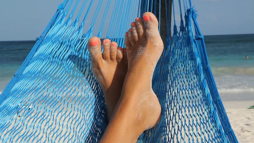 Hammock feet.  Feet up in a hammock. Tulum, Mexico.