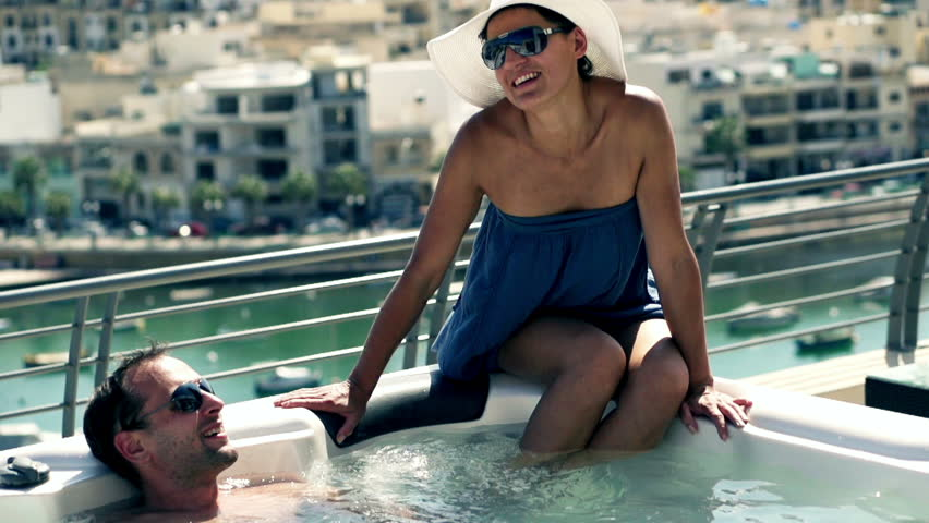 Rich people having fun in jacuzzi, slow motion shot at 120fps