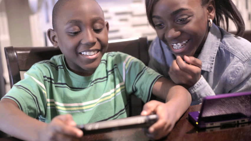 African American Black Kids playing video games
