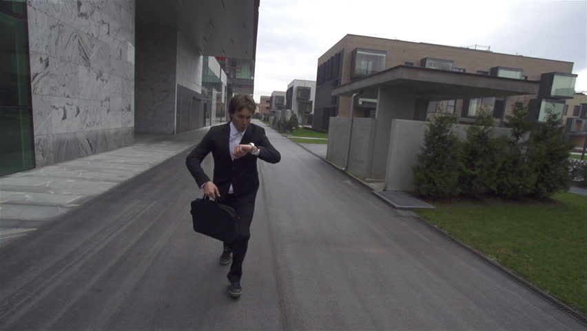 SLOW MOTION: Businessman running late - HD stock video clip