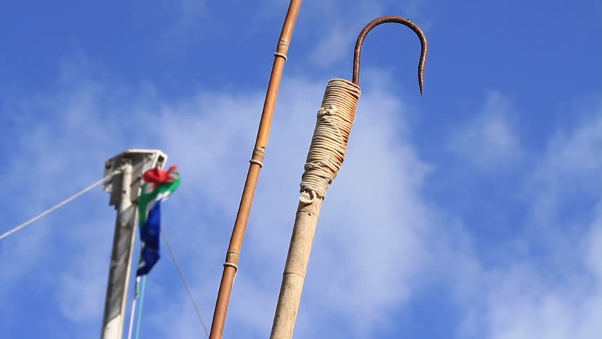 Tuna fishing gaff hook with south african flag stock for Fishing gaff hook