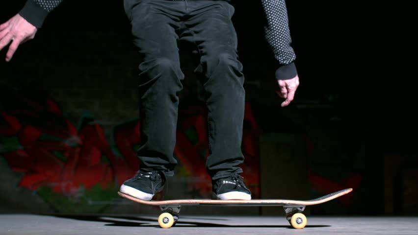 Skater doing ollie trick on concrete in slow motion - HD stock video clip