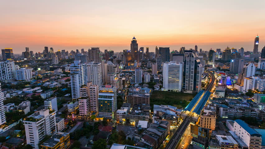 BANGKOK - 30 MARCH: Time lapse view of Bangkok skyline at sunset. Top view of Nana on Sukhumvit road on 30 March 2013 in Bangkok, Thailand. Nana is one of Bangkok red light district. - HD stock video clip