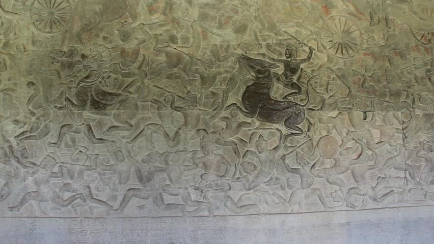 Wide shot pan from large bas relief carved mural of battle for Bas relief mural