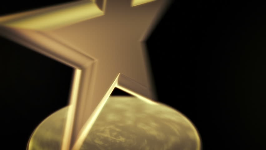 Gold Star Award - Spinning award statue in gold, ideal for any award ceremony with copy space at the end to put your own text or logo.