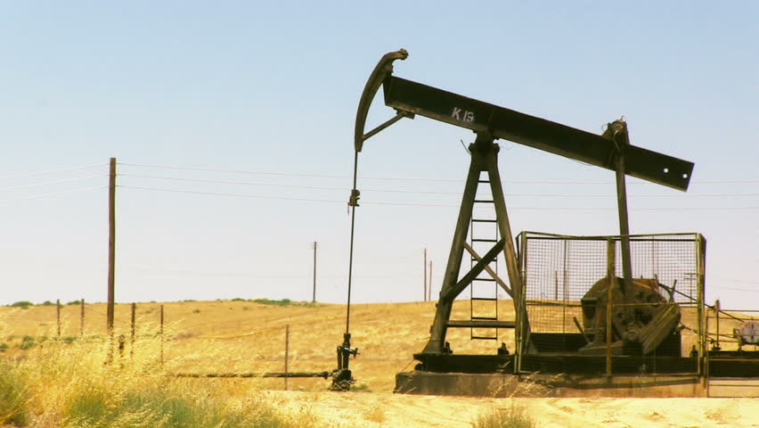Oil Rig Pumping in California - HD stock footage clip
