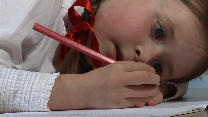 Little girl writing whilst at school - HD stock footage clip