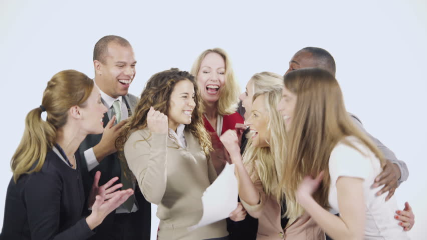 Attractive and dynamic group of young professionals having a team talk, isolated on white. One female shares exciting news about a deal or a business contract and the rest of the team shout and cheer