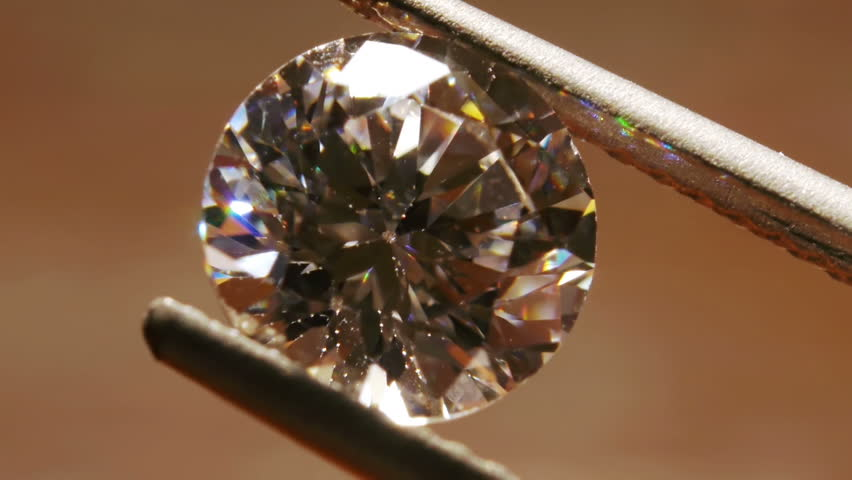 Diamond Seen Close Up With Pincers