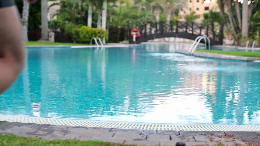 man jumping into swimming pool stock footage video 3847211 shutterstock