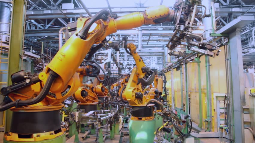 Robotics work in production line of car parts at factory