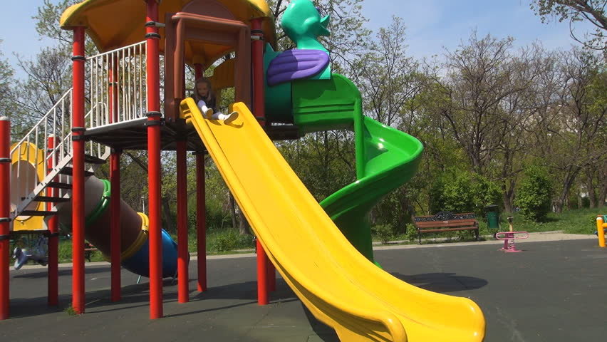 Child Sliding on a Slide in Park, Little Girl Playing at Playground, Children - HD stock video clip
