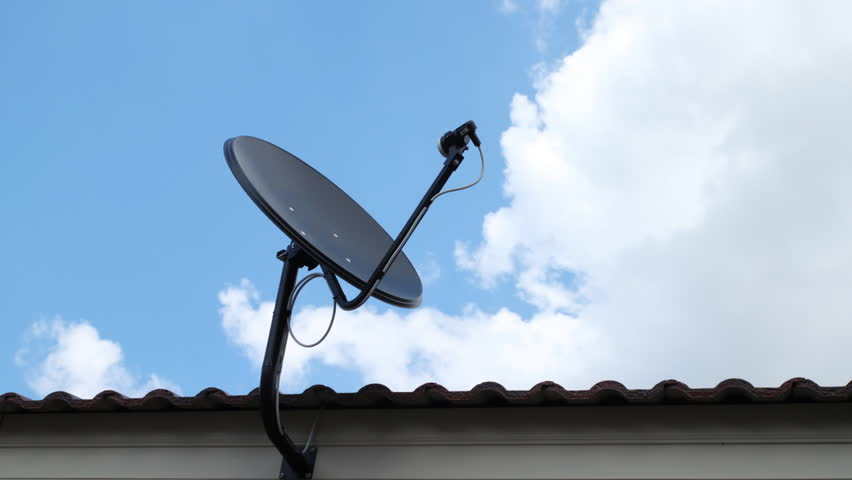 black antenna communication satellite dish over sky, time-lapse - HD stock footage clip