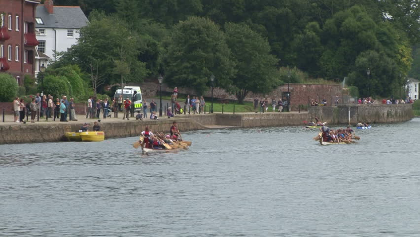 EXETER, UK - SEPTEMBER 2012: A race between two viking boats. - HD stock footage clip