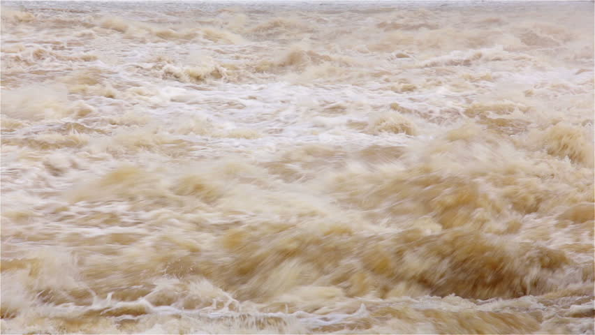Flood on the river. Flowing water. Hydroelectric power station. - HD stock footage clip