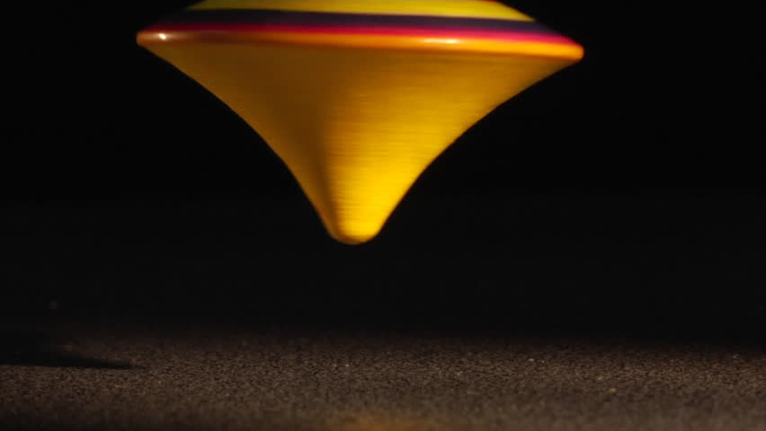 spinning top in the dark - HD stock video clip