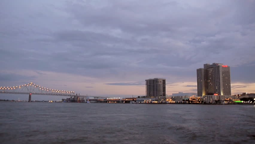 New Orleans, Louisiana -  June, 2011 - Wide shot of sailing away from New Orleans on the Mississippi River.