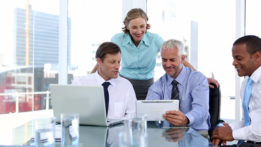 Group of business people using laptop and tablet computer during a meeting