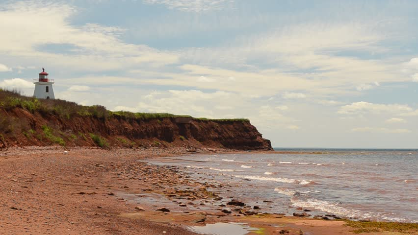 A lighthouse on the shore on Prince Edward Island - HD stock footage clip