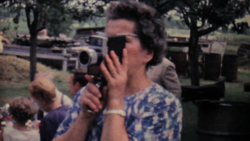 JOHNSTOWN, NEW YORK, 1962: A lady films a large family picnic in the summer of 1962 with her 8mm moving camera.