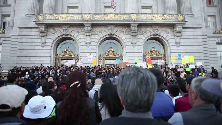SAN FRANCISCO, CA - CIRCA MAY 2010: Wide shot of a crowd of people, mostly Asians, particularly Chinese, at a rally outside of city hall.