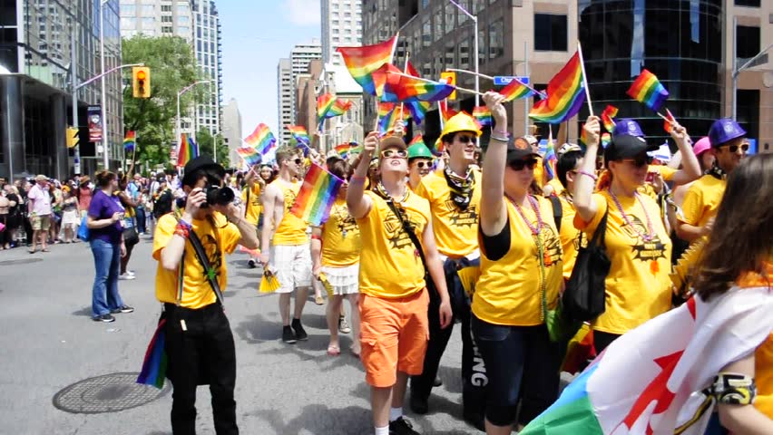 TORONTO - JUNE 30, 2013:  Pride Parade the closing activity of the Toronto Pride Festival which celebrates the history and future of the Gay Allies as seen on June 30, 2013 in Toronto, Canada