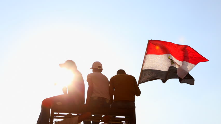 CAIRO, EGYPT - 2013: Protestors wave the Egyptian flag in Cairo, Egypt