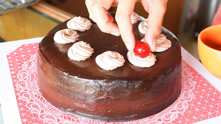 Red cherry topping on chocolate cake - HD stock footage clip