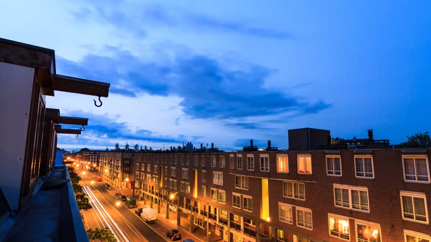 Beautiful full HD 30fps timelapse looking out over Amsterdam, the Netherlands. It spans over 12 hours and contains moving shadows, a sunset, moonrise and sunrise over the city. - HD stock video clip